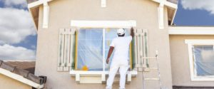 Our staff doing paint work on a property